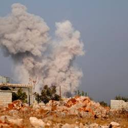 Smoke billows following airstrikes by pro-government forces on the village of Kafr Nabl, in Syria's southern Idlib province on November 13, 2019. - AFP