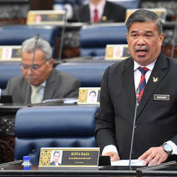 Defence Minister Mohamad Sabu tabling the Defence White Paper at the Dewan Rakyat yesterday. — Bernama