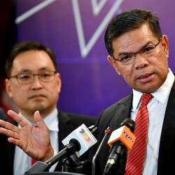 Minister of Domestic Trade and Consumer Affairs (KPDNHEP) Datuk Seri Saifuddin Nasution Ismail (right), speaking to a press conference at the ministry's monthly assembly in Putrajaya today. — Bernama