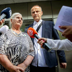 "A member of a group of victims' relatives, ""the Mothers of Srebrenica"" answers journalists' questions in front of Dutch supreme court on July 19, 2019 in the Hague, following the ruling in the cassation proceedings regarding the responsability of Dutch state in Srebrenica massacre. — AFP"