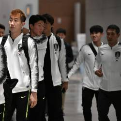 South Korean national football team players arrive at Incheon airport in Incheon early on October 17, 2019 after the World Cup 2022 Qualifying Asian zone Group H football match between South Korea and North Korea which held at Kim Il Sung Stadium in Pyongyang. - AFP