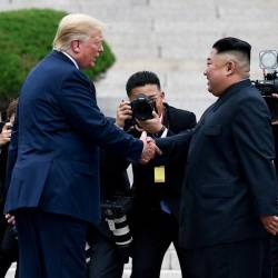 File photo taken on June 30 shows North Korea's leader Kim Jong Un shakes hands with US President Donald Trump north of the Military Demarcation Line that divides North and South Korea, in the Joint Security Area (JSA) of Panmunjom in the Demilitarized zone (DMZ). — AFP