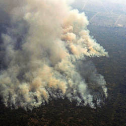 Aerial picture showing smoke from a 2-km-long stretch of fire billowing from the Amazon rainforest about 65 km from Porto Velho, in the state of Rondonia, Brazil, on Aug 23, 2019. — AFP