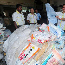 MPK licensing deputy director, Mohd Fahrulisa Md Isa (right), shows the plastic waste that is kept in the factory at Air Hitam, Klang today.