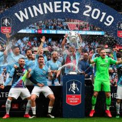 Manchester City's Belgian captain Vincent Kompany (C) lifts the winner's trophy as the players celebrate victory after the English FA Cup final football match between Manchester City and Watford at Wembley Stadium in London, on May 18, 2019. — AFP