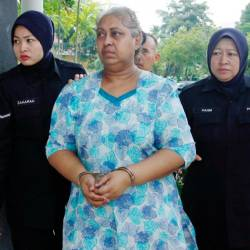 Ambika M. A. Shan, 60, being led to the Bukit Mertajam Magistrate's Court in Penang on Feb 21, 2018. — BBX