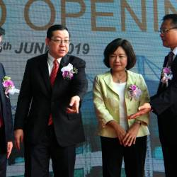 Finance Minister Lim Guan Eng (2nd from L) and Penang Chief Minister Chow Kon Yeow (L) talk with Hotayi Malaysia Chairman Datuk Lee Hung Lung (R) and representative of the Taipei Economic and Cultural Office in Malaysia, Anne Hung at the opening ceremony of the Hotayi Factory in Batu Kawan industrial area, June 15, 2019. - Bernama