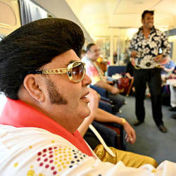 Picture shows Elvis fans leaving from Central Station in Sydney as they head to the Parkes Elvis Festival, some 300 kilometres (190 miles) west of Sydney in outback Australia. — AFP