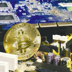 A copy of bitcoin, a type of digital asset, is shown standing on a PC motherboard. Existing digital asset operators in Malaysia have until Friday to identify themselves to the SC. - REUTERSPIX
