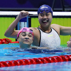 Malaysia's Phee Jinq En celebrates winning the women's 50m breaststroke final today in New Clark City — Reuters