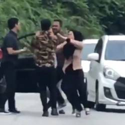 Woman trades blows with man for honking at her in traffic
