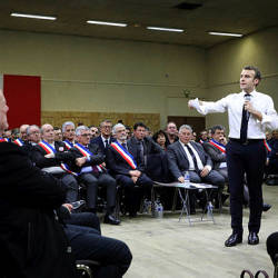 French President Emmanuel Macron addresses a meeting with some 600 mayors of Occitania to relay their constituent's grievances on Jan 18, 2019 in Souillac, southern central France. — AFP