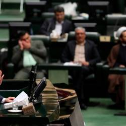 Iran's President Hassan Rouhani (L) delivers a speech to present the budget for the financial year starting late March 2020 to the parliament in Tehran on December 8, 2019. - AFP