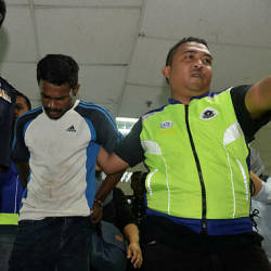 K. Sathiaraj, 27, was arraigned in Magistrate's Court and Ampang Sessions Court today on three counts of raping, sexually assaulting and killing an 85-year-old elderly woman last month.