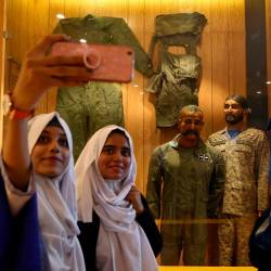 Students take selfies with a mannequin, representing Indian pilot Wing Commander Abhinandan Varthaman, after his Mig-21 fighter aircraft was shot down by Pakistan Air Force on February 27, 2019, at a gallery 'Operation Swift Retort' at the Pakistan Air Force (PAF) Museum in Karachi, Pakistan November 13, 2019. - Reuters