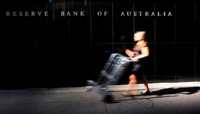 Australia cuts rates to record low on virus fears 1