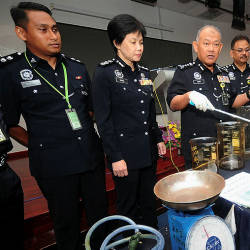 Fire at shop house leads to discovery of drug lab, drugs worth RM1.65m seized