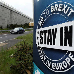 "A ""No To Brexit"" sign is pictured on the outskirts of Newry in Northern Ireland on June 7, 2016. The border that divides the island of Ireland is now invisible, with just a few crumbling former customs buildings serving as reminders of a bygone era of a hard frontier between north and south. — AFP"