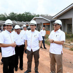 Economic Affairs Minister Datuk Seri Mohamed Azmin Ali (3rd R) during a visit to Felda's new generation housing project at Palong 8 in Negri Sembilan. — Bernama