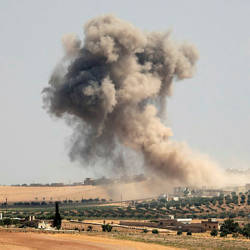 Smoke billows during pro-regime bombardments in the area of Maar Hitat in Syria's northern Idlib province on August 20, 2019. — AFP