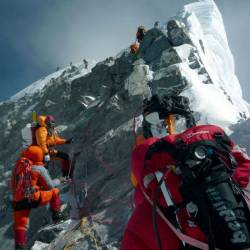 Mountaineers walk past the Hillary Step while pushing for the summit of Mount Everest. — AFP Relaxnews