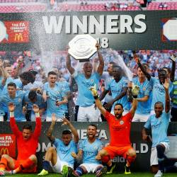 Manchester City celebrate winning the community shield with the trophy at the Wembley Stadium in London, on Aug 5, 2018. — Reuters