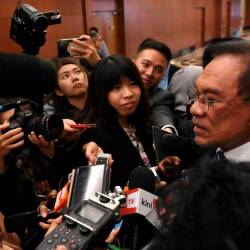 Port Dickson MP and PKR President Datuk Seri Anwar Ibrahim speaks to reporters at the Parliament lobby today. - Bernama
