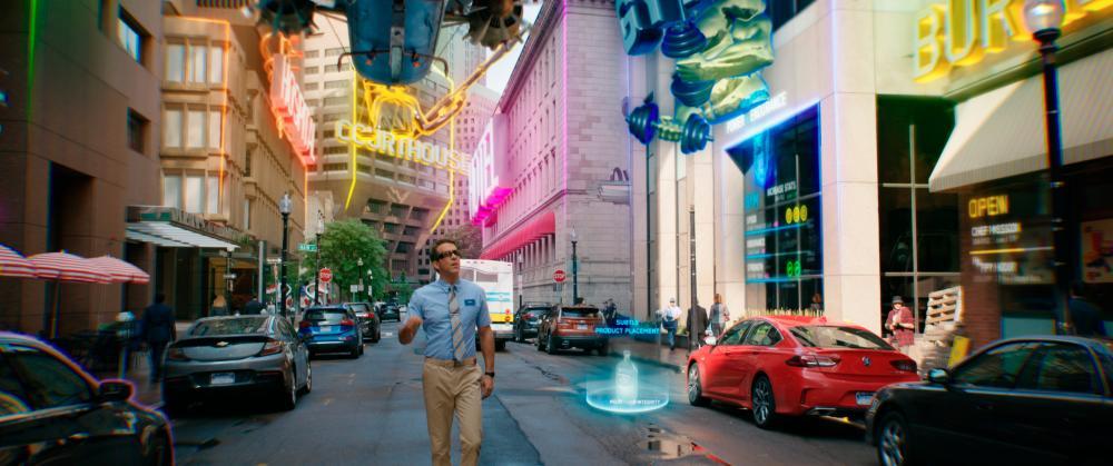 Guy roaming around Free City. Courtesy of 20th Century Studios. © 2020 Twentieth Century Fox Film Corporation. All Rights Reserved.