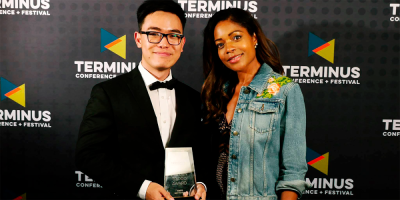 Soon (left) with actress Naomi Harris after receiving an award for his first film Something Carved and Real at the Terminus Conference + Festival Campus Moviefest in San Francisco.