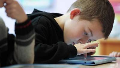 Heavy screen time appears to impact childrens' brains. — AFP