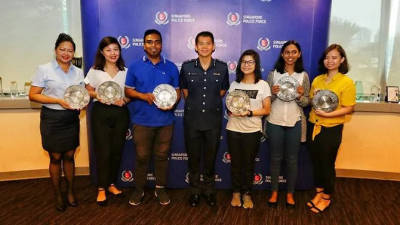 From L-R: Rhea Maria Rosa, Maria Leong, Muhammad Talip Ajman Ali, Assistant Commissioner of Police Gregory Tan, Ng Rui Ashlynna, Hemaa Shruthi Sekar, and Cheong Pei Lin Debbi. — Photo from Singapore Police Force