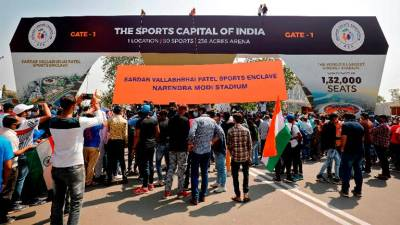 Excited Indian fans stream into world's biggest cricket stadium