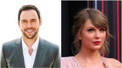 Scooter Braun (L) and Taylor Swift.