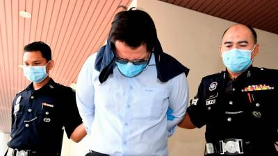 Doctor Dr Neoh Soon Khai, 39, was charged in the George Town magistrates' court today for dishonestly retaining stolen property. - Bernama