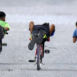 Three underage children are seen racing on 'lajak' bicycles at Bukit Besar, Terengganu. — Bernama