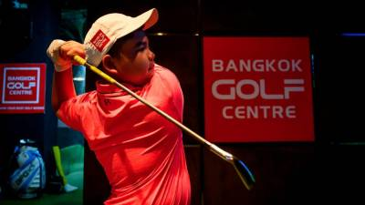 This picture taken on Aug 16, 2019, shows Poomrapee Top Gun Kaewpiboon practising his swing at the Bangkok Golf Centre in Bangkok. — AFP