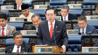 Finance Minister Lim Guan Eng presents the 2020 Budget at the Parliament, on Oct 11, 2019. — Sunpix by Norman Hiu