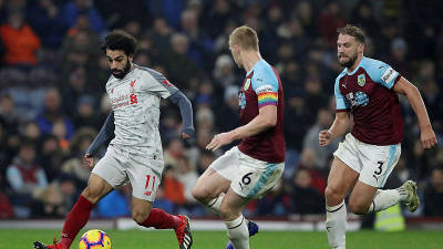 Burnley's Charlie Taylor and Ben Mee closely mark Mo Salah. — Reuters