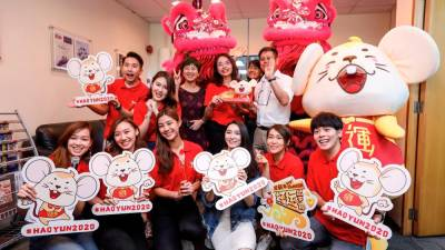 (top row, third from left) theSun general manager advertising & marketing Lee Siew Siew, Toh, Wong, and theSun managing editor Eddie Hoo celebrates 2020 Chinese New Year with the teams from both Astro and theSun. ASHRAF SHAMSUL/THESUN