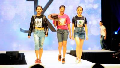 Volunteers from ARP Elite Models wearing clothes designed through the Autism RuL3s Fashion - Powered By Gifted Minds project. – COURTESY OF JK FASHION.