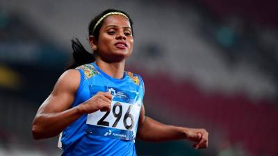 In this file photo taken on Aug 26, 2018 India's Dutee Chand competes in a semi-final heat of the women's 100m athletics event during the 2018 Asian Games in Jakarta. — AFP
