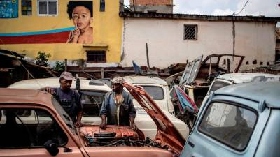 Elyse Rakotondrakonona (right) in front of a Renault 4L in his workshop in Antananarivo's Antoamadikina neighbourhood, on Nov 6. The iconic French car was in production between 1961 and 1992 and till 1994 in Slovenia.