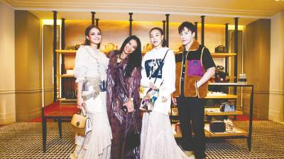 (from left) Nur Fazura, Anggun, Dizzy Dizzo and Lawrence Wong at the reopening of Coach Suria KLCC.