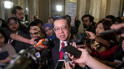 Finance Minister Lim Guan Eng speaks at a press conference at the Parliament lobby today. — Bernama