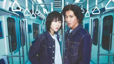 Leah Dou (left) and Takuya Kimura star in the 'Free to Move' campaign.