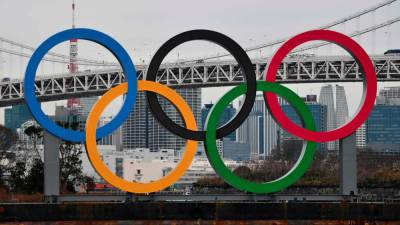 In this file photo taken on Jan 17, a large size Olympic Symbol (W32.6m x H15.3m) is brought by a salvage barge to install at Tokyo Waterfront, in the waters of Odaiba Marine Park. — AFP