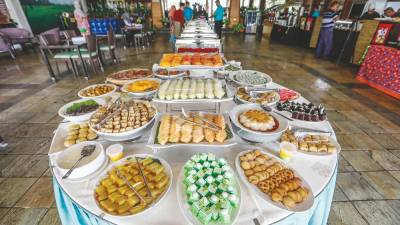 The spread for the Bazar Sajian Muhibah has something for everyone, including sushi. – ASHRAF SHAMSUL/THESUN