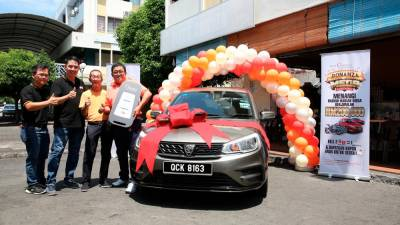 From left: Nestlé Professional Regional Sales Manager – Sarawak Chiong Choo Ming, Nestlé Professional National Sales Manager East Malaysia and Brunei Kho Guan Yaw, Pete's Corner owner Hee Cheng Beng and Nestlé Professional Bonanza Mega Contest first prize winner Ho Fuk Khong with his new Proton Saga Standard 1.3 (A) car.