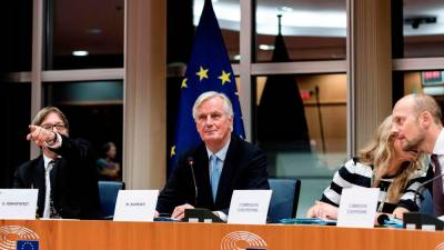 European Union's chief Brexit negotiator Michel Barnier (C) looks on prior to a meeting at the European Parliament in Brussels, on Oct 16, 2019. — AFP