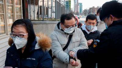 China urges overseas Chinese to stay away as imported virus cases rise 1